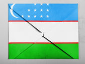 Uzbekistan flag painted on grey envelope — Stock Photo