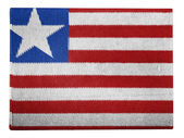 Liberia. Liberian flag painted on carton box — Stock Photo