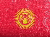 Kyrgyzstan flag painted on bubblewrap — Stock Photo