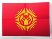 Kyrgyzstan flag painted on simple paper sheet — Stock Photo