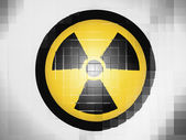 Nuclear radiation symbol painted on on wavy plastic surface — Stock Photo