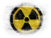 Nuclear radiation symbol painted on on dotted surface — Stock Photo