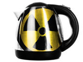 Nuclear radiation symbol painted on shiny metallic kettle — Stock Photo