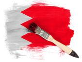 Bahrain. Bahraini flag painted with brush over it — Stock Photo