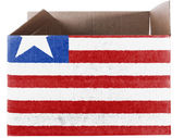 Liberia. Liberian flag painted on carton box or package — Stock Photo