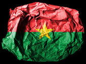 Burkina Faso flag painted on crumpled paper on black background — Stock Photo
