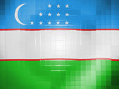 Uzbekistan flag on wavy plastic surface — Stock Photo