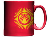 Kyrgyzstan flag painted on coffee mug or cup — Stock Photo