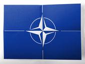 Nato symbol målad på enkelt papper blad — Stockfoto