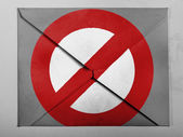 Forbidden sign painted on painted on grey envelope — Stock Photo