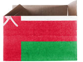 Oman flag painted on carton box or package — Stock Photo