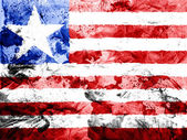 Liberia. Liberian flag painted dirty and grungy paper — Stock Photo