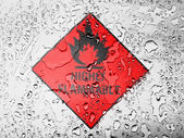 Highly flammable sign drawn on covered with water drops — Stok fotoğraf