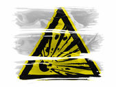 Explosive sign drawn on painted with three strokes of paint in white — Stock Photo