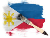 Philippine flag painted with brush over it — Stock Photo