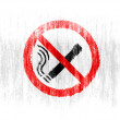 Stock Photo: No smoking sign drawn on white background with colored crayons