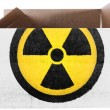Nuclear radiation symbol painted on carton box or package — Stock Photo #23442470