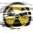 Nuclear radiation symbol painted on painted on paper with colored charcoals — Stock Photo #23443308