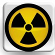 Nuclear radiation symbol   painted on glossy icon — Stock Photo