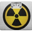 Stock Photo: Nuclear radiation symbol painted on painted on balance