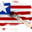 Stock Photo: Liberia. Liberiflag painted with brush over it