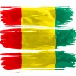 The Guinean flag - Stock Photo