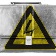 Electric shock sign painted on small briefcaseor leather handbag — Stock Photo