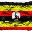 Uganda flag  painted on crumpled paper - Stock Photo