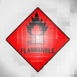 Highly flammable sign drawn on  on wavy plastic surface — Stockfoto