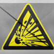 Explosive sign drawn on painted on grey envelope — Stock Photo