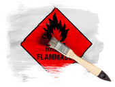 Highly flammable sign drawn on painted with brush over it — Stock Photo