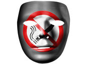 No smoking sign drawn painted on theater plastic mask — Stock Photo