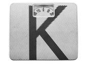 K letter painted on balance — Stock Photo