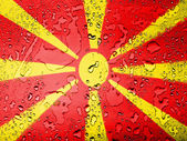 Macedonia flag covered with water drops — Stock Photo