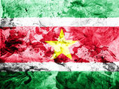 Surinamese flag painted dirty and grungy paper — Stock Photo