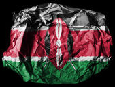 Kenya flag painted on crumpled paper on black background — Stock Photo