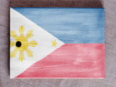 Philippine flag painted over wooden board — Stock fotografie