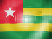 Togo flag on wavy plastic surface — Stock Photo