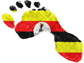 Uganda flag painted in a shape of footprint — Stock Photo