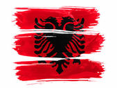Albania. Albanian flag painted with three strokes of paint in white — Stock Photo