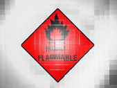 Highly flammable sign drawn on on wavy plastic surface — Stock Photo