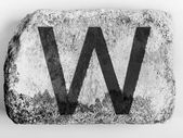 W letter painted on brick — Stock Photo