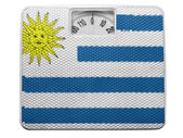 Uruguay flag painted on balance — Stock Photo