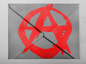 Anarchy symbol painted n painted on grey envelope — Stock Photo