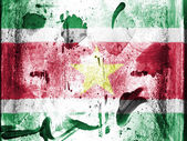 Surinamese flag painted on grunge wall — Stock Photo
