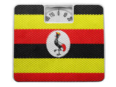 Uganda flag painted on balance — Stock Photo