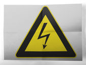 Electric shock sign painted on simple paper sheet — Stock Photo