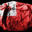 Tonga flag painted on crumpled paper on black background - Stock Photo