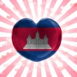 Cambodia flag painted on glass heart on stripped background — Stock Photo #23452148