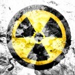 Nuclear radiation symbol painted dirty and grungy paper — Stock Photo